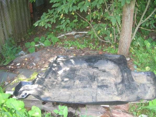 Резиновый коврик, новый, в багажник Волги 3110