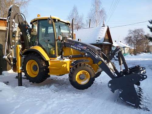Вывоз снега,услуги современного экскаватора-погрузчика Volvo