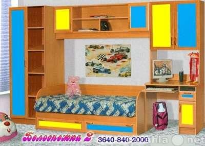 Детская комната с кроватью и шкафами