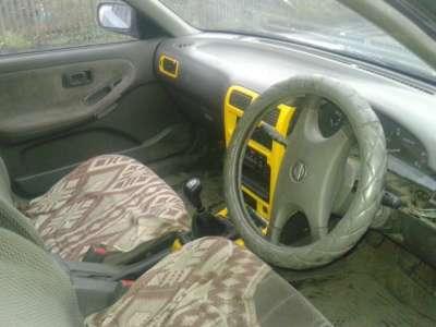 подержанный автомобиль Nissan Sannu