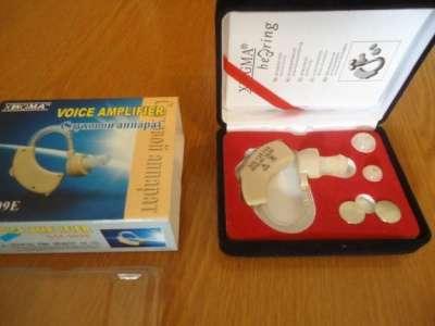 Заушный слуховой аппарат.